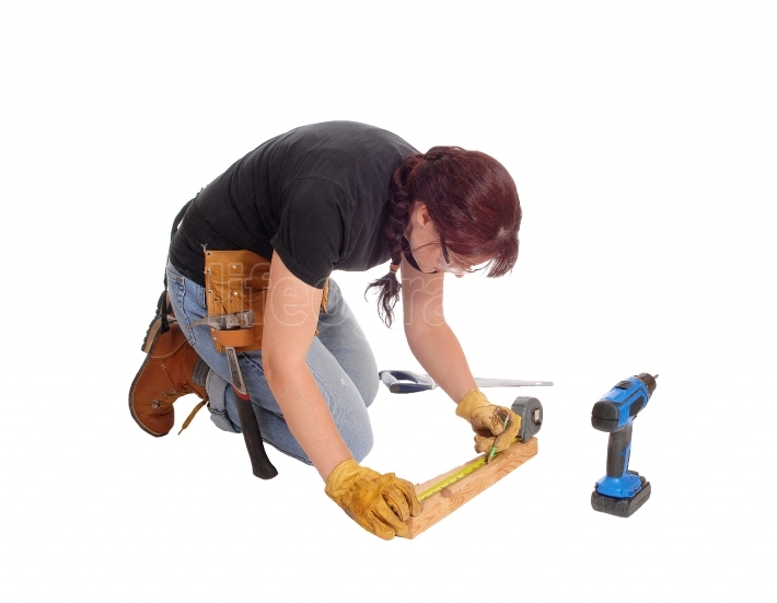 Woman working with tools.