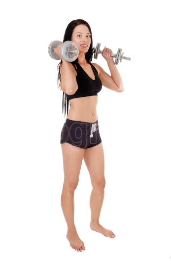 Woman workout whit two dumbbells smiling, bare feet