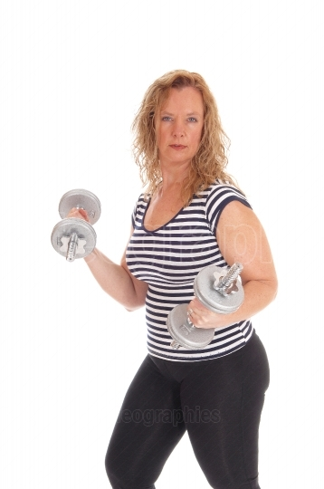 Woman workout with dumbbells.
