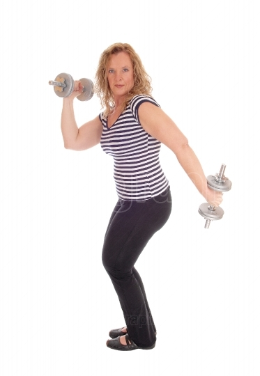 Woman workout with two dumbbells.