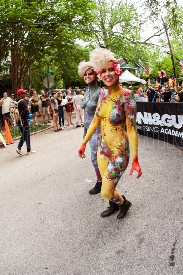 Women Wearing Body Paint Smile While Walking In Atlanta Parade