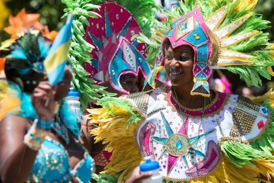Women Wearing Elaborate Feathered Costumes Celebrate Caribbean C