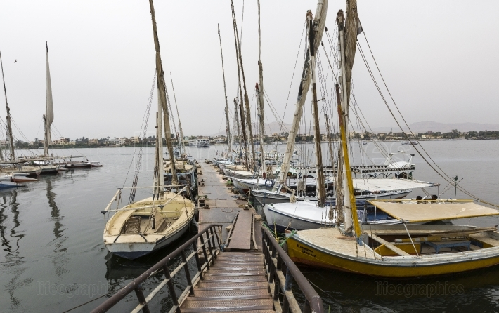 Wooden boats felucca at the nile river in aswan, egypt, north af