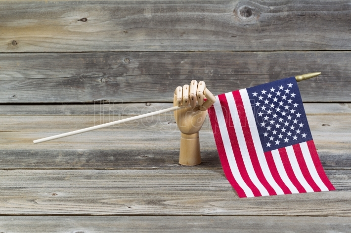 Wooden Hand holding American Flag