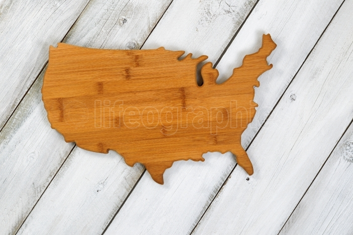 Wooden shape of USA on rustic white boards