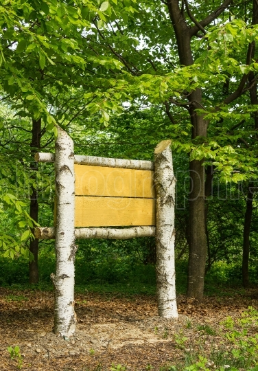 Wooden sign board in the woods