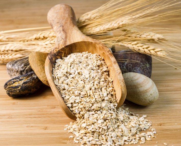 Wooden spoon filled with Raw Rolled Oats