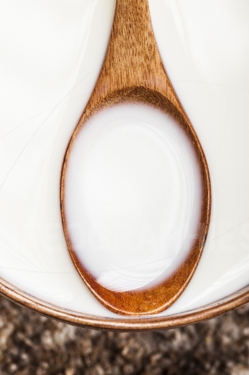 Wooden spoon with milk
