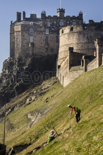 Workers digging ground beside Edinburgh Castle, Scotland