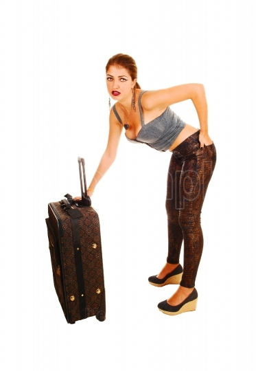 Worried girl with suitcase