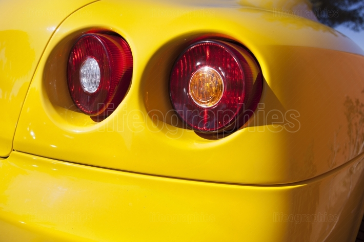 Yelllow sports car spot lights