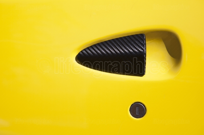 Yellow car door handle