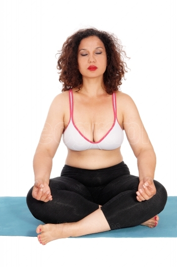 Yoga woman sitting on floor.