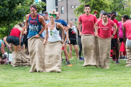Young Adults Participate In Sack Race At Atlanta Field Day