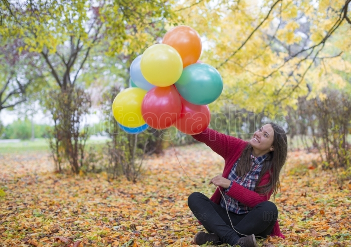 Young and beautiful woman enjoying her balloons