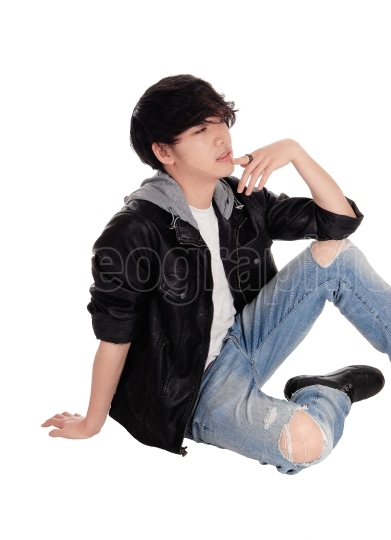 Young Asian man sitting on floor