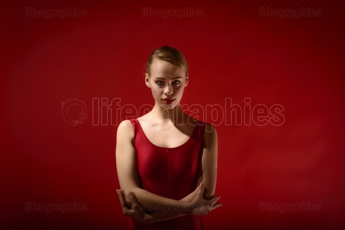 Young beautiful dancer posing in studio