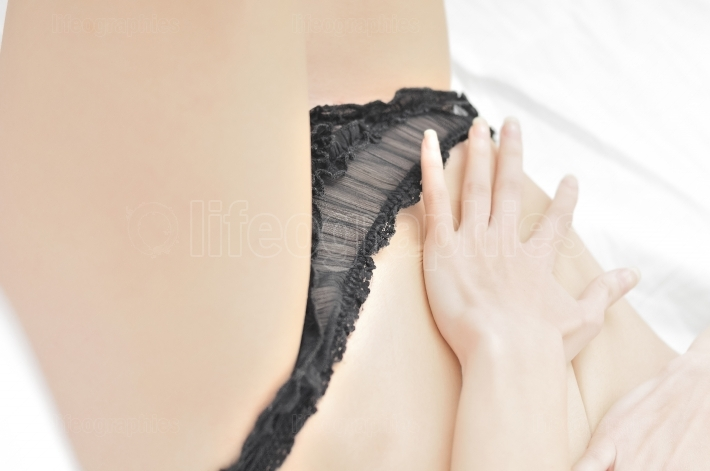 Young beautiful slim woman with black pantie