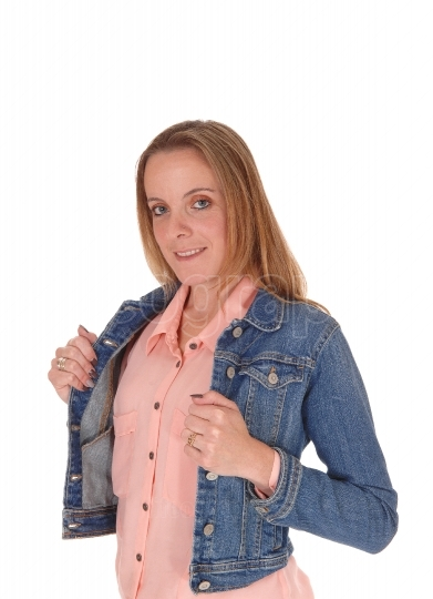 Young blond woman standing in jeans jacket