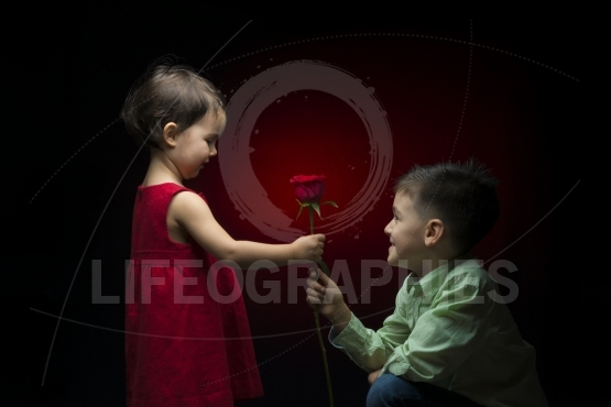 Young boy giving a rose to a little girl