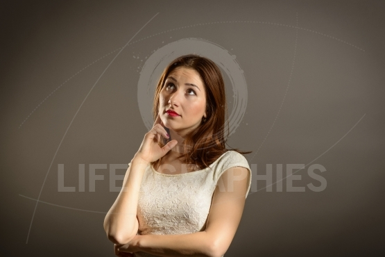 Young business woman looking aside