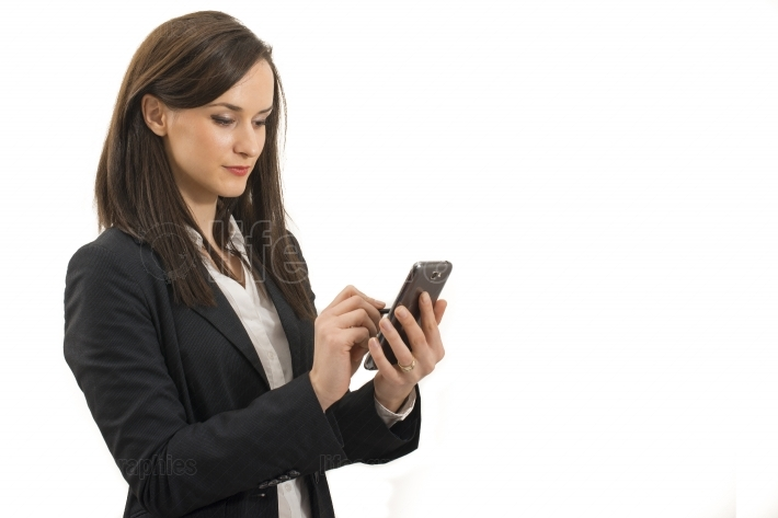 Young businesswoman looks at cellphone