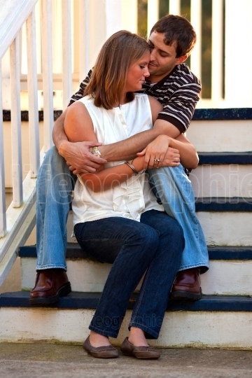 Young Couple In Love Embrace On Gazebo Steps