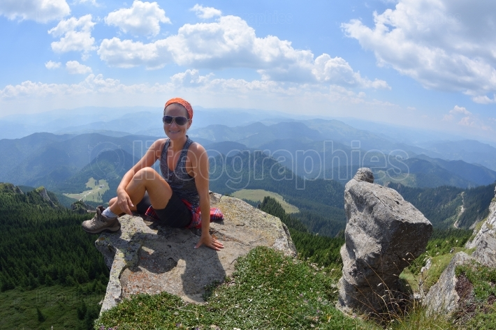 Young female tourist in alpine zone in summer