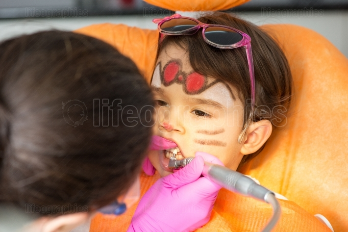 Young girl at dentist. dental treatment