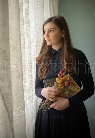 Young girl in black vintage dress