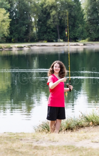 Young Girl lands little fish
