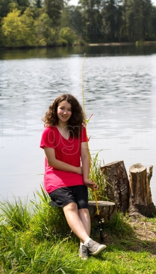 Young Girl sitting on tree stump while taking a break from fishi