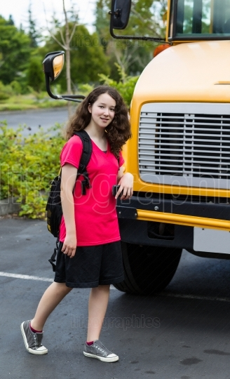 Young Girl Student Leaving School Bus