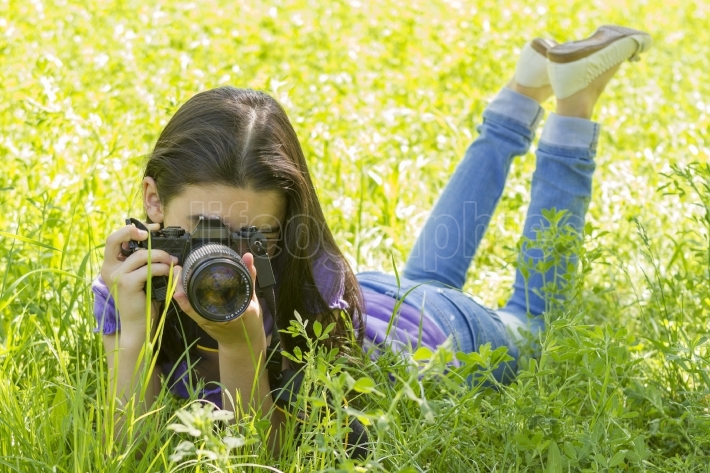 Young girl taking photos