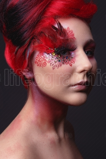 Young girl with red hair and creative ingenious makeup