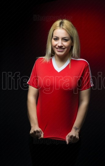 Young girl with red t-shirt. polish soccer fan