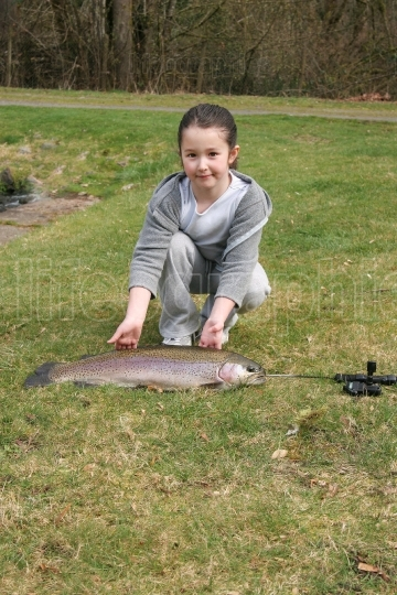 Young Girls catches large fish