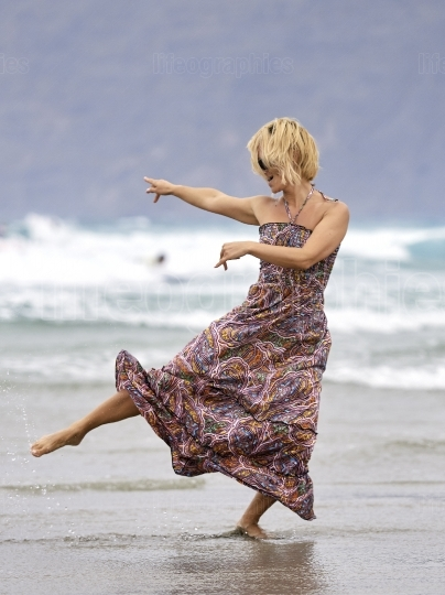 Young happy woman on the beach