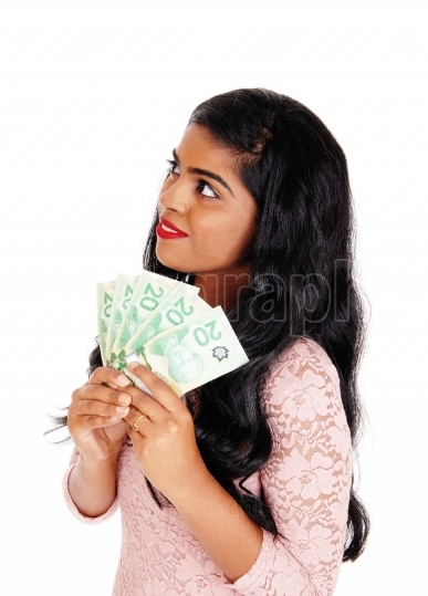 Young indian woman holding money.