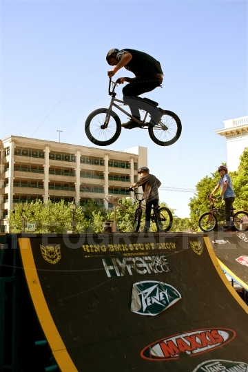 Young man practices jumps for bmx competition