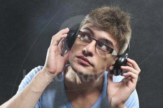 Young man with headphones and black glasses