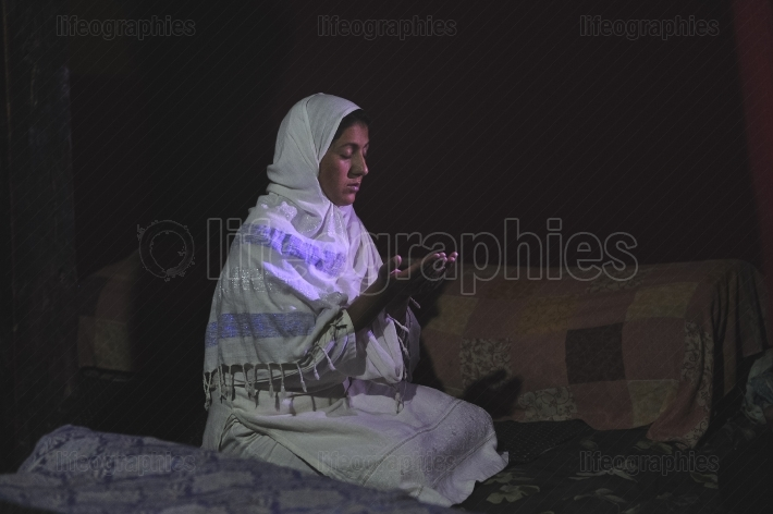 Young muslim woman pray in her house