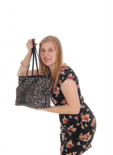 Young pretty woman standing her handbag