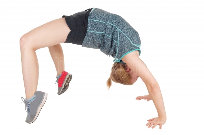 Young slim woman doing gymnastics