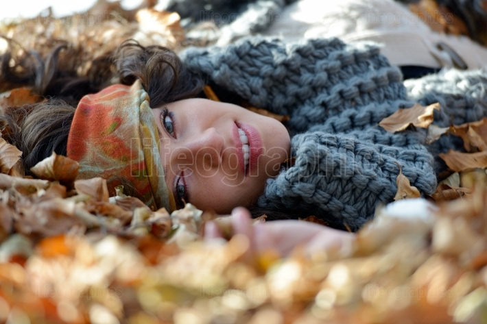 Young smiling woman outdoor in autumn