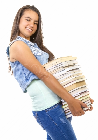 Young student girl holding a stack of books