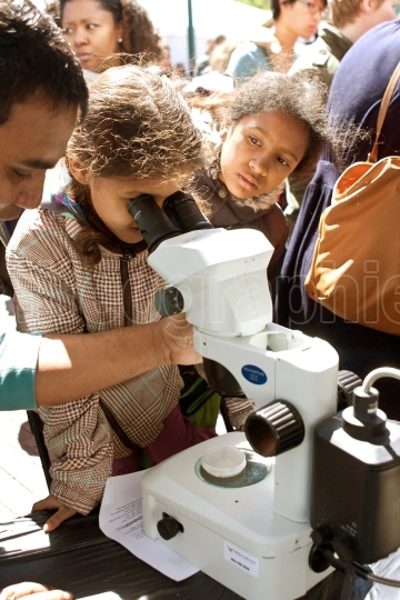 Young Student Looks Through Digital Microscope At Atlanta Scienc
