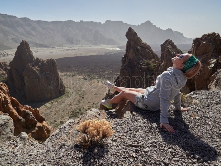 Young woman admiring landscape in Teide Natural Park, Tenerife