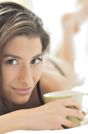 Young woman and the cup of coffee