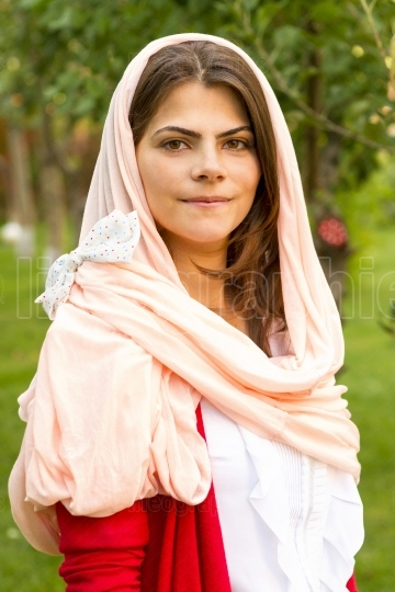 Young woman in pink scarf